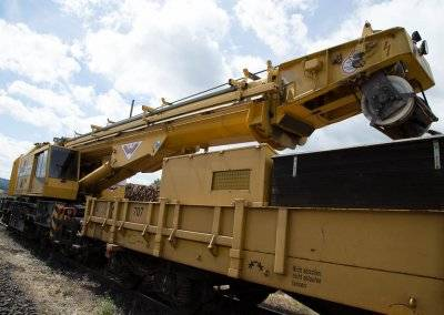 The crane plays an important role in the success of track construction work.